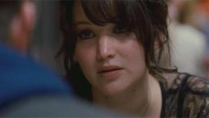 Jennifer Lawrence tenta tirar o melhor de Bradley Cooper